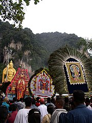 Murugan Icons carried in procession during Thaipusam at Batu Caves.