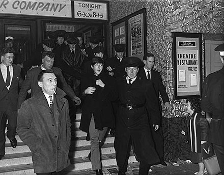 The Beatles emerging from the Ritz Cinema, Belfast following their concert, 8 November 1963. The Beatles emerging from the Ritz Cinema, Fisherwick Place, Belfast November 8, 1963.jpg