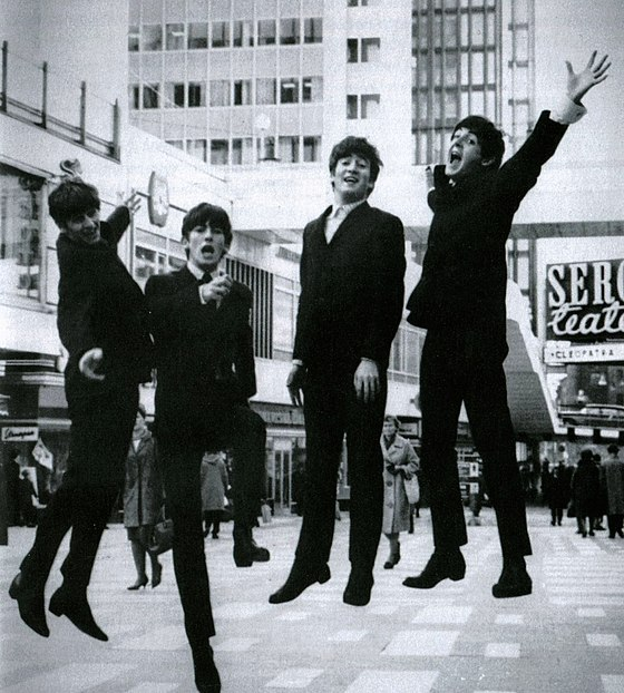 "The arrival of the Beatles in the US during 1964, and particularly their appearance in the TV show ""The Ed Sullivan Show"", marked the beginning of the British invasion in the history of music, in which a large number of rock and pop music acts from the United Kingdom gained enormous popularity in the US The Beatles i Hotorgscity 1963.jpg"