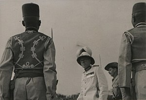 Gambia Regiment - Sir Hilary Blood, Governor of the Gambia, inspecting a guard of honour provided by Gambia Regiment soldiers, c. 1940s.