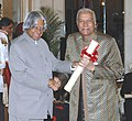 The President, Dr. A.P.J. Abdul Kalam presenting the Padma Bhushan Award – 2006 to an eminent maestro of classical vocal music Ustad Ghulam Mustafa Khan, in New Delhi on March 20, 2006.jpg