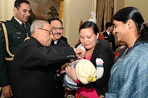 Former Indian president Pranab Mukherjee launching the Nationwide Polio Programme by administering Polio Drops