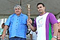 The Prime minister of Samoa, Mr. Susuga Tuilaepa Lupesoli'ai Sa'ilele Malielegaoi hands over the Queen's Baton Delhi 2010 to a former Commonwealth Games Weight lifting Silver Medalist, Ofisa Ofisa in Samoa on May 11, 2010.jpg
