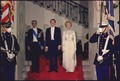 The Shah of Iran, President Nixon, and Mrs. Nixon in formal attire for a state dinner in the White House - NARA - 194302.tif