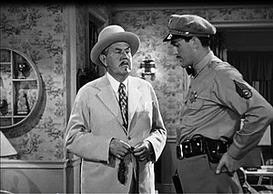 Kirk Alyn - Alyn (right) in the film The Trap (1946).