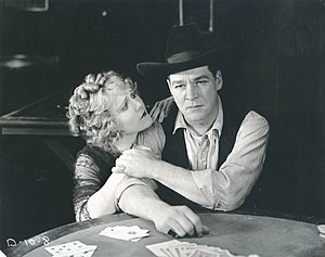 William Russell (American actor) - Louise Lovely and William Russell in a scene still for the 1920 Fox production The Twins of Suffering Creek.