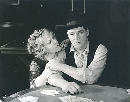 Louise Lovely and William Russell in a scene still for the 1920 Fox production The Twins of Suffering Creek.