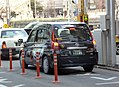 The rearview of Toyota JPN TAXI TAKUMI (DAA-NTP10-AHXGN) as a taxi of TSUBAME TAXI.jpg