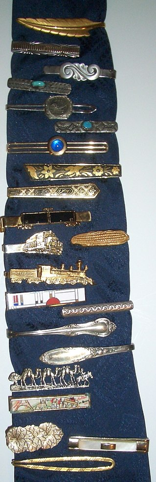 A selection of tie clips, mostly from the early to mid 20th century Tie clips wiki.jpg