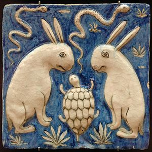 Zakariya al-Qazwini - Tile with two rabbits, two snakes and a tortoise. Illustration for Zakariya al-Qazwini's book, Marvels of Things Created and Miraculous Aspects of Things Existing (13th century). Earthenware, molded and underglaze-painted decoration. Iran, 19th century.