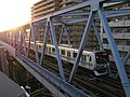 Tokyo Metro 05-142 running from Minami-Sunamachi to Nish-Kasai.jpg