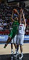 Tomas Delininkaitis attacks the basket.jpg