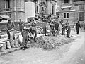 Troops from the Grenadier Guards constructing sandbag defences around government buildings in Birdcage Walk, London, May 1940. H1584.jpg