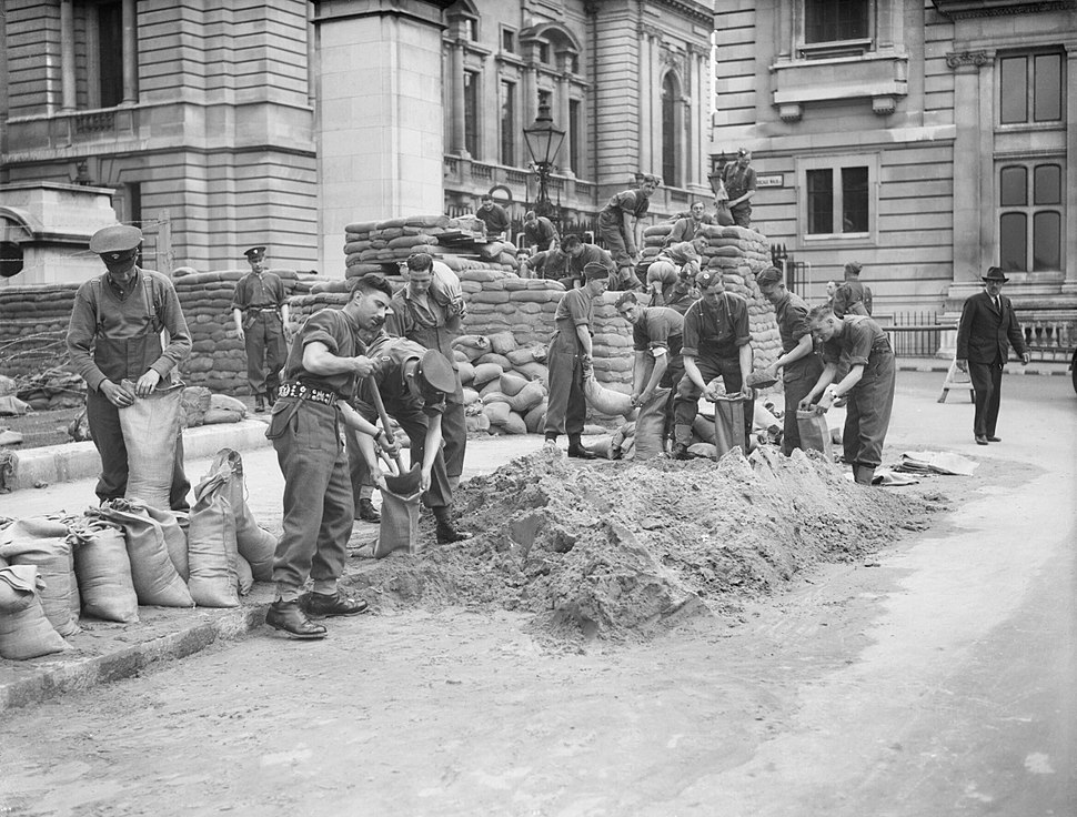 Troops from the Grenadier Guards constructing sandbag defences around government buildings in Birdcage Walk, London, May 1940. H1584