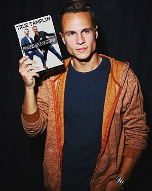 Waist-up Photo of True Tamplin Holding Book