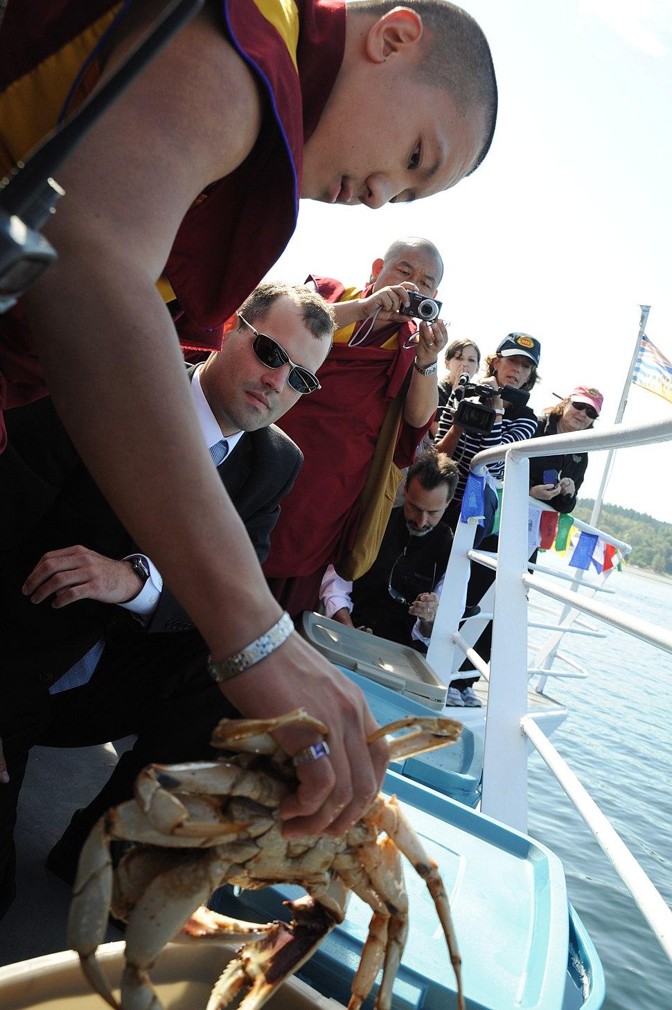 Tibetan monk releases a crab into the ocean