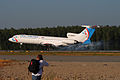Tu-154M and a planespotter at Domodedovo 30-Jul-2010.jpg