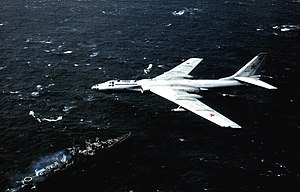 Tupolev Tu-16 above Soviet cruiser 1984.jpg