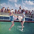 "Two ladies in swimming costumes in the ""Greasy Pole"" competition aboard the Empress of Canada (5074439827).jpg"