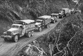U.S.-built Army trucks wind over the Ledo supply road now open from India into Burma - NARA - 535540.tif