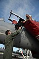 U.S. Air Force Lt. Col. Gregory Pickette, left, the assistant director of operations with the 67th Fighter Squadron, hands his gear to Airman 1st Class Dylan Wheeler, a tactical aircraft maintainer with the 18th 130827-F-NA975-048.jpg