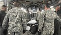 U.S. Airmen and Soldiers load a simulated natural disaster casualty onto an Air Force C-17 Globemaster III aircraft March 31, 2014, during an evacuation drill as part of a mission assurance exercise during 140331-F-LX370-222.jpg