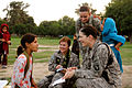 U.S. Army Capts. Marie Orlando, center, and Alison Salerno, bottom right, and Air Force Tech. Sgt. Melissa Kemp speak Pashto with an Afghan Girl Scout during a Girl Scout meeting on Forward Operating Base 100821-F-FW394-299.jpg