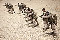 U.S. Marines with the 26th Marine Expeditionary Unit's maritime raid force fire M4 carbines and M1911 .45-caliber pistols at a range in Jordan June 9, 2013, during Eager Lion 2013 130609-M-SO289-025.jpg