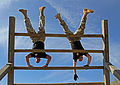 U.S. Soldiers with the 3rd Squadron, 1st Cavalry Regiment descend an obstacle during a confidence course at Fort Benning, Ga., March 21, 2014 140321-A-IP604-776.jpg