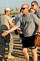 US Army 51604 BAGHDAD - Second Lt. Stuart Redus, a platoon leader, from San Antonio, congratulates players at a softball tournament celebrating Hispanic Heritage Month, Sept. 24. Though his team lost, he enjoyed h.jpg