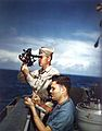 US CQM takes sextant reading on USS Alaska (CB-1) 1945.jpg