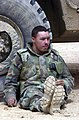 US Navy 030408-N-5362A-021 Private Christopher Busby from Paymane, Ala., rests after a long ride in a convoy from Kuwait to the central Iraqi city of Najaf.jpg