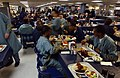 US Navy 030425-N-6967M-203 Crew members take time to get a bite to eat on the mess decks of the USNS Comfort (T-AH 20).jpg