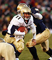 US Navy 031108-N-2899A-001 Navy Quarterback Craig Candeto outmaneuvers a Notre Dame defender.jpg