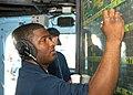 US Navy 040206-N-9392E-002 Operation's Specialist Seaman Laton Brown, from Washington D.C., plots information on the status board.jpg