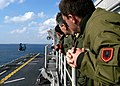 US Navy 040310-N-6380E-039 Albanian Navy pilots aboard the amphibious assault ship USS Wasp (LHD 1) viewed flight operations as an effort to familiarize friendly nations with Wasp's mission.jpg