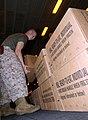 US Navy 050101-M-5538E-031 Lance Cpl. Dustin L. Folkes helps prepare pallets of Meals Ready to Eat (MREs) for victims of the recent Tsunami in the Indian Ocean.jpg
