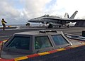 US Navy 050129-N-2838C-001 Aviation Boatswain's Mate Equipment 1st Class Tran Miles from Virginia Beach, Va., directs an F-A-18C Hornet assigned to the Romans of Strike Fighter Squadron One Zero Six (VF-106) onto one of the fou.jpg