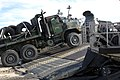 US Navy 050215-M-1195M-067 A M23 seven-ton truck, assigned to the 26th Marine Expeditionary Unit (MEU) drives up the ramp of a U.S. Navy Landing Craft Air Cushion (LCAC).jpg