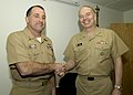 US Navy 050315-N-3442D-002 Chief of Naval Reserve Force, Vice Admiral John Cotton, congratulates Master Chief Petty Officer David Pennington as the new Navy Reserve Force Command Master Chief.jpg