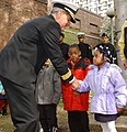 US Navy 050425-N-4729H-062 Commander, Navy Recruiting Command, Rear Adm. Jeffrey Fowler, greets children at General George McCall Elementary School.jpg
