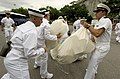 US Navy 050629-N-9693M-299 Prospective Midshipmen retrieve their.jpg