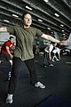 US Navy 050715-N-3136P-025 Aviation Boatswain's Mate 3rd Class Mary Lynch of Norwalk, Calif., works out with fellow air department Sailors in the hangar bay.jpg