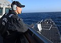US Navy 061110-N-0684R-133 Seaman Nicholas Pennington stands watch from the pilot house aboard the Arleigh Burke-class guided missile destroyer USS Preble (DDG 88).jpg
