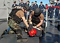 US Navy 070702-N-6710M-028 Members of the visit, board, search and seizure (VBSS) team aboard USS Tortuga (LSD 46) demonstrate the proper weapons tactics for a group of embarked midshipman.jpg