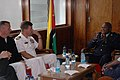US Navy 070917-N-3255B-002 Cmdr. Dean Vesely, commanding officer of guided-missile destroyer USS Forrest Sherman (DDG 98), and Capt. Nicholas H. Holman, commander of Southeast Africa Task Group 60.5, discuss maritime safety and.jpg