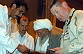 US Navy 070925-M-9719V-063 Navy Cmdr. David Lemme consults with Afghan National Army doctors regarding a patient's prescription.jpg