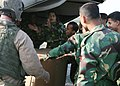 US Navy 071123-M-7696M-044 A Bangladeshi soldier celebrates the arrival of bottled water delivered by Marines of Marine Medium Helicopter Squadron (HMM) 261, the aviation element of the 22nd Marine Expeditionary Unit (MEU).jpg
