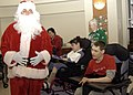 US Navy 071226-N-4669J-021 Aviation Electrcian's Mate 1st Class Jeff Dietz, dressed as Santa, visits with children at the St. Mary's Home for Disabled Children.jpg
