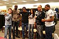 US Navy 080103-M-5276L-020 Ultimate Fighting Championship (UFC) fighters and the ring card girl stand together during the UFC Affliction autograph signing at the Marine Corps Air Station Miramar Marine Corps Exchange.jpg